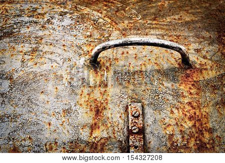 abstract background or texture Handle on the old rusty iron hatch