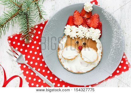 Christmas Santa pancake with strawberry for kid breakfast top view