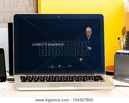 PARIS FRANCE - OCT 28 2016: Apple Computers website on new MacBook Pro Retina with OLED Touch bar in geek creative room showcasing Apple Keynote - Tim Cook about Unified TV experience