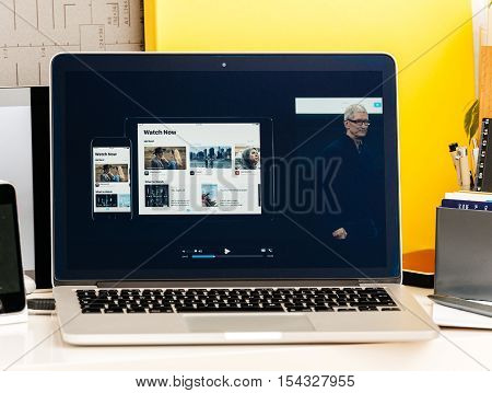 PARIS FRANCE - OCT 28 2016: Apple Computers website on new MacBook Pro Retina with OLED Touch bar in geek creative room showcasing Apple Keynote presentation of Apple tv Watch now TV app channels movies and shows