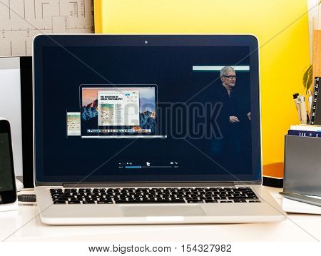 PARIS FRANCE - OCT 28 2016: Apple Computers website on new MacBook Pro Retina with OLED Touch bar in geek creative room showcasing Apple Keynote presentation of Tim Cook talking about Macbook Pro