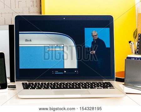 PARIS FRANCE - OCT 28 2016: Apple Computers website on new MacBook Pro Retina with OLED Touch bar in geek creative room showcasing Apple Keynote history of iBook laptop computer