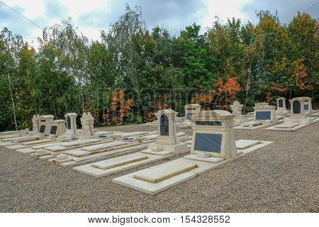 New graves at the cemetery memorial gardens in autumn