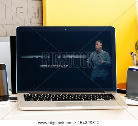 PARIS FRANCE - OCT 28 2016: Apple Computers website on new MacBook Pro Retina with OLED Touch bar in geek creative room showcasing Apple Keynote presentation of laptop performance CPU GPU and Thunderbolt 3 ports