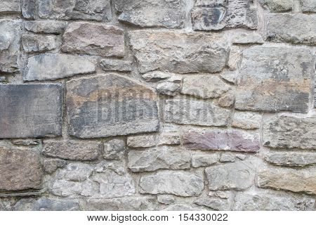 old stone brick wall as a texture background