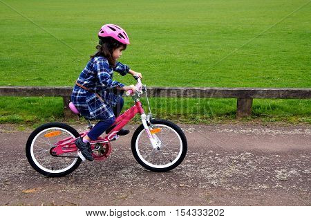 Happy Little Girl Learns How To Ride A Bike