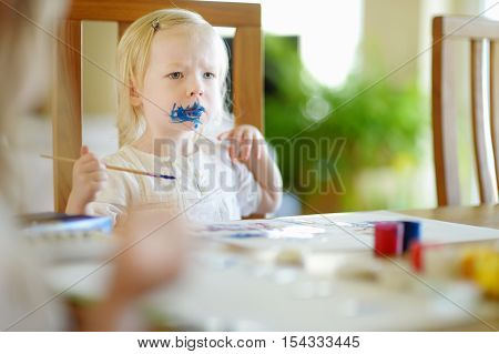 Funny Grimy Toddler Girl Painting
