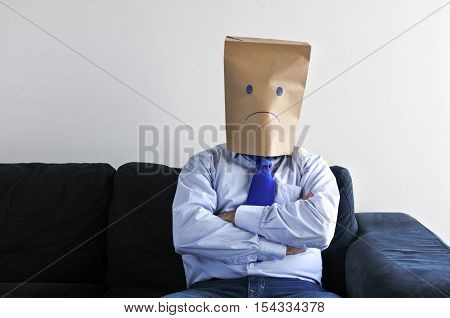 Anonymous Sad Man Sit On The Couch Alon