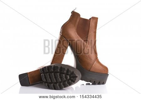 Stylish brown boots, isolated on white background
