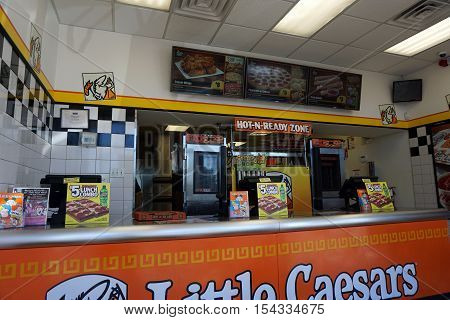 PLAINFIELD, ILLINOIS / UNITED STATES - SEPTEMBER 19, 2016: One may purchase pizza at Little Caesars, in a Plainfield strip mall.