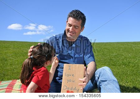 Young Girl Gives Her Father Flower And A Card