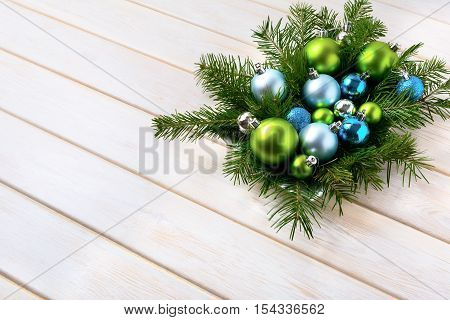 Christmas dinner table centerpiece with navy blue and green ornaments. Christmas party decoration with shiny balls. Christmas greeting background. Copy space.