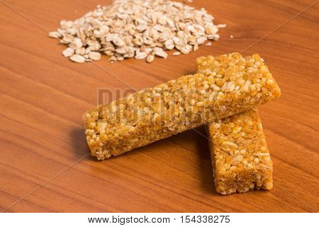 Muesli Bars. Nutri Oat Protein Bars over a wooden table