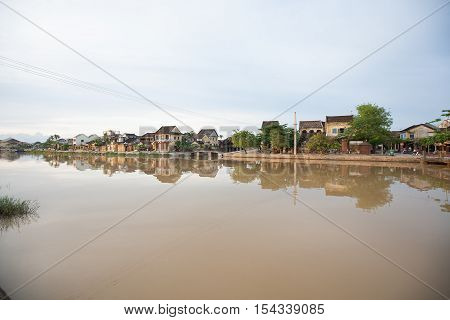 View across the Song Thu Bon River, to the  world heritage listed old city of Hoi An, Vietnam, on the  South China Sea coastline.