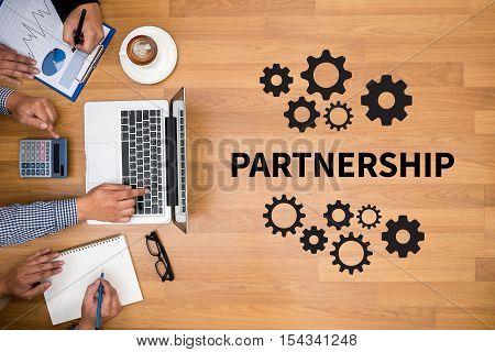 PARTNERSHIP Strategic Partnership on the gearwheels Businessman