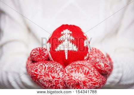 Christmas ball in hands. Winter decoration