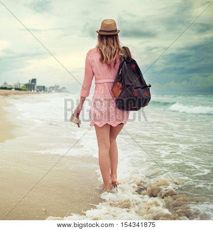 Beautiful woman walking along the South beach, Miami