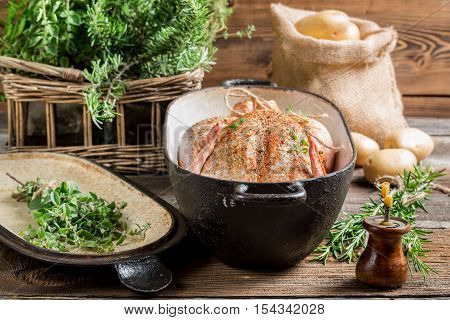 Chicken in casserole dish spiced with herbs