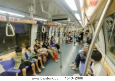 Abstract blur Passengers in a crowded Mass Rapid Transit (MRT) subway train