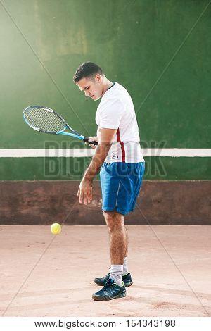 Handsome Young Man On Tennis Court. Man Playing Tennis. Man Throwing Tennis Ball