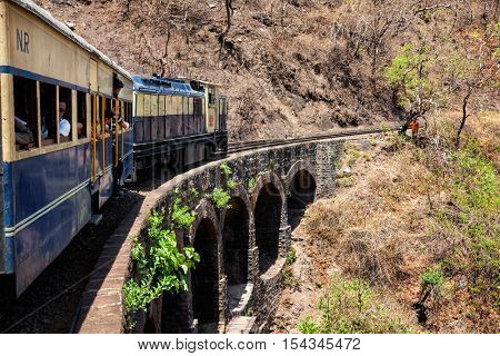 HIMACHAL PRADESH, INDIA - MAY 12, 2010: Toy train of Kalka ??Shimla Railway - narrow gauge railway built in 1898 and famous for its scenery and improbable construction. UNESCO World Heritage Site