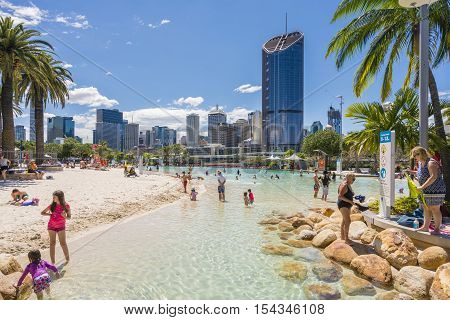 Brisbane, Australia - September 25, 2016: View of people swimming at the Streets Beach, inner-city and man-made beach, with skyscrapers in the background in South Bank, Brisbane.