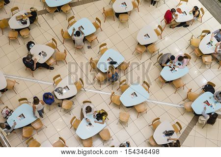 Brisbane, Australia - September 26, 2016: People dining in food court in Myer Centre, the largest food court, in Brisbane CBD.