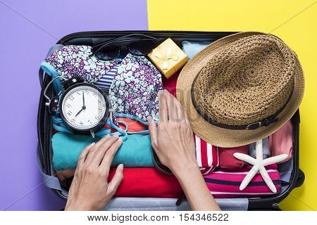 woman packing a luggage for a new journey poster