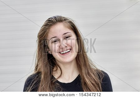 Head Shot Of A Happy Smiling Young Woman