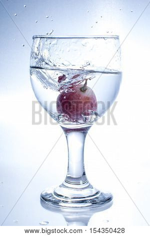 art of throwing grape into the water