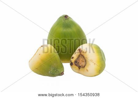 three unripe coconuts on isolated white background