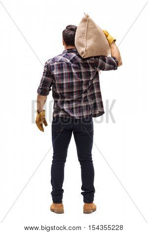 Full length rear shot of a male farmer holding a burlap sack on his shoulder isolated on white background
