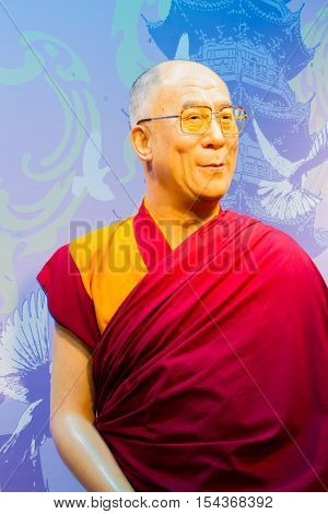 BANGKOK THAILAND - DECEMBER 19: Wax figure of the famous Dalai Lama from Madame Tussauds on December 19 2015 in Bangkok Thailand.
