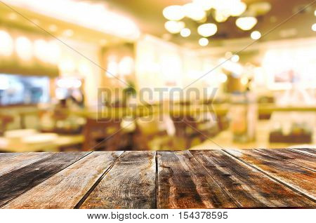 Empty wooden table in hotel room blur background.