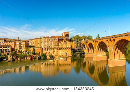 Albi in Southwestern France. Albi is a world heritage UNESCO site. Albi is famous for Toulouse-Lautrec and the Cathedral Saint Cecile. View of the Tarn River and the Cathedral Saint Cecile.