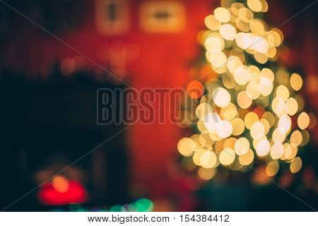 Beautiful  Defocused Background New Year Room With Decorated Christmas Tree, Gifts And Fireplace Wit