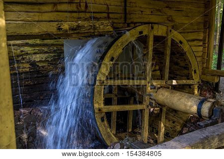 Working watermill wheel with falling water in the village in Voronezh Region