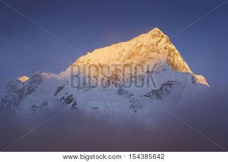 Last golden light before sunset at Lhotse-Everest Mountain. During the way to Everest base camp. Sagarmatha national park. Nepal.
