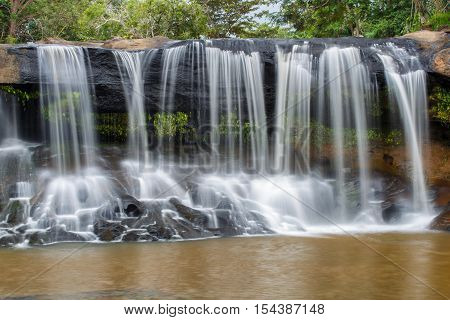 Tat Ton Waterfall The beautiful waterfall in deep forest during raining season at Tat Ton National Park Ubon Ratchathani province Thailand.