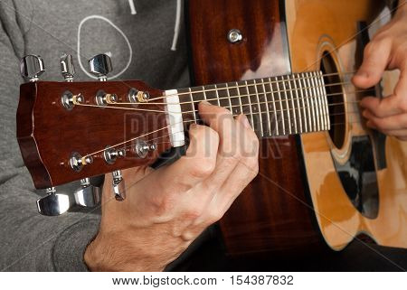 Man's hand playing the guitar. The concept of discipleship. Music background
