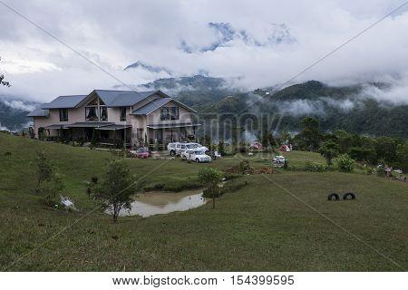 SABAH,BORNEO,Bundu Tuhan, Kundasang-August 29,2016: Cloudy sky scenery of Mount Kinabalu from Hounon Ridge Farmstay