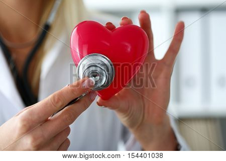 Female Medicine Doctor Hold In Hands Red Toy Heart