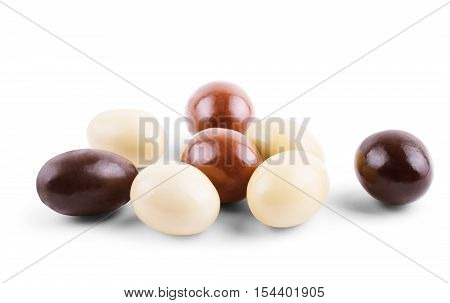 closeup of some different ball-shaped chocolates made with black chocolate white chocolate and milk chocolate