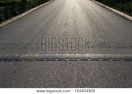 texture background of the asphalted road or the highway and a hump for reduction in the rate of the movement of vehicles