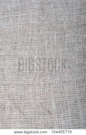 The texture of coarse cloth. Sackcloth. Eco fabric. Natural fabric. The folds of the fabric. Background.