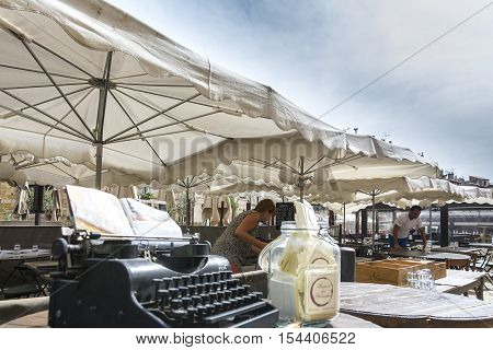 AIX EN PROVENCE,FRANCE-AUGUST 9,2016:A small town square with bars and restaurants to receive tourists in Aix en Provence during a sunny day.