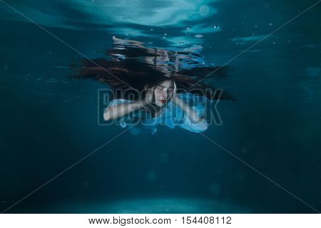 Woman with long hair floating in the water.