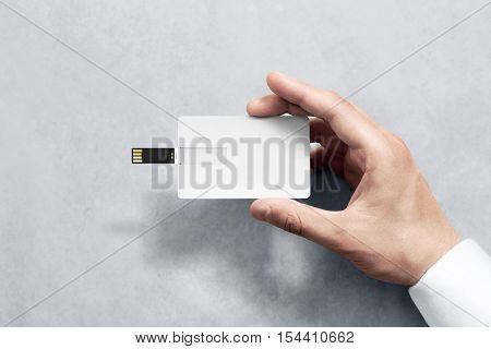 Blank white plastic wafer usb card design mockup holding hand. Visiting flash drive namecard mock up. Call-card disk souvenir presentation. Flat credit stick adapter. Bussiness favor in mans arm