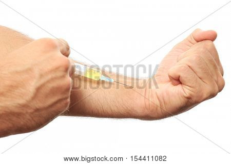 Muscular man injecting steroids on white background
