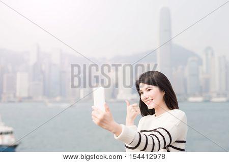 beauty woman selfie and thumb up in hongkong